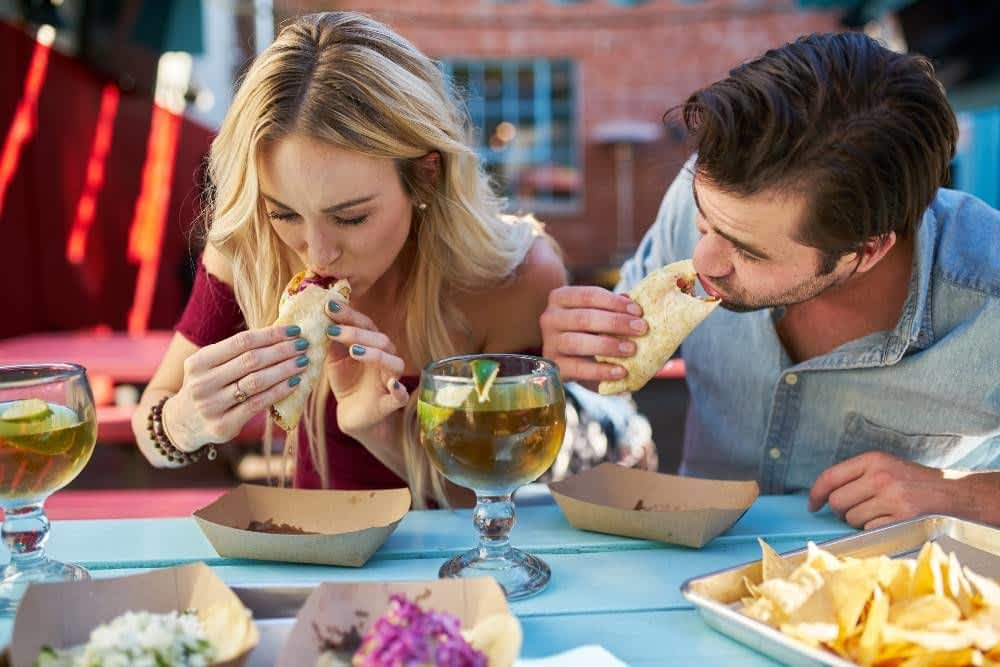 Couple eating Tacos