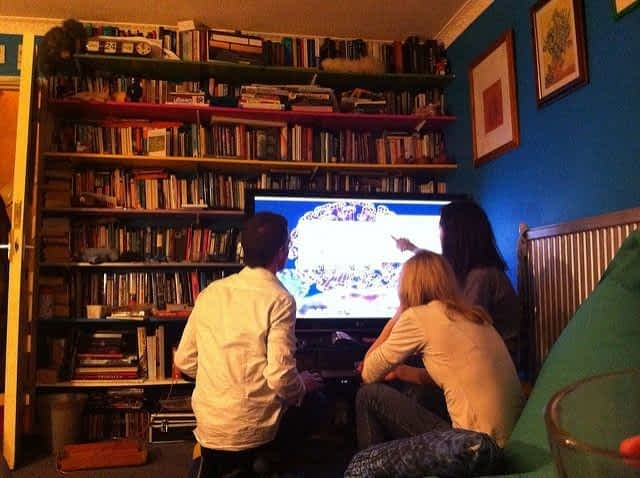 Couchsurfing Travelers playing videogames