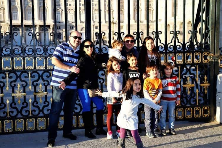 family taking a picture at Madrid Palace